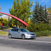Universit of Calgary main campus, arch, car driving in motion