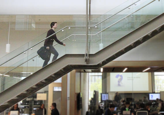 Walking up the stairs.