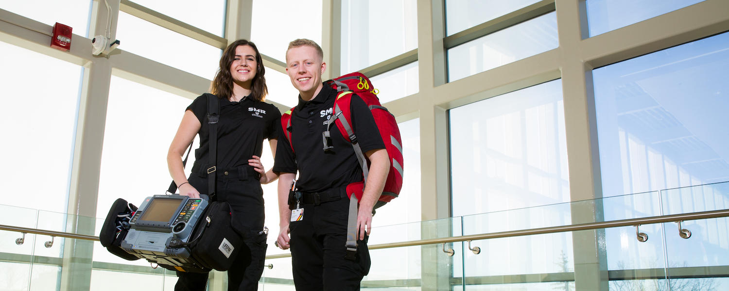 two student medical response volunteers in uniform