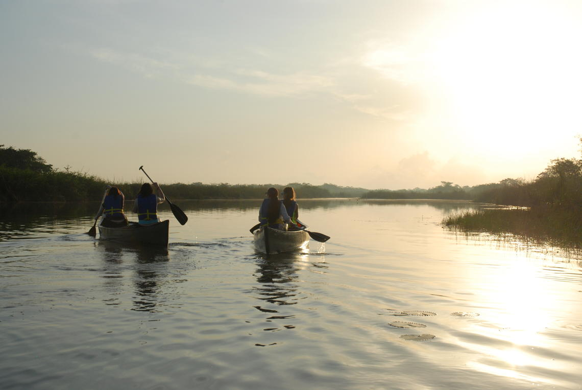 image of students rowing canoes in Belize