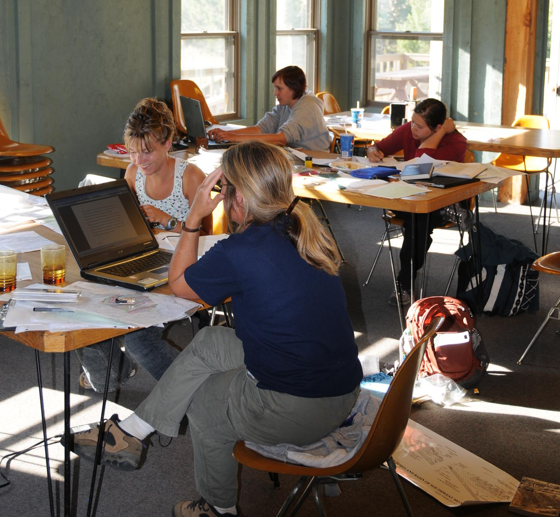 Image of students working inside cottage