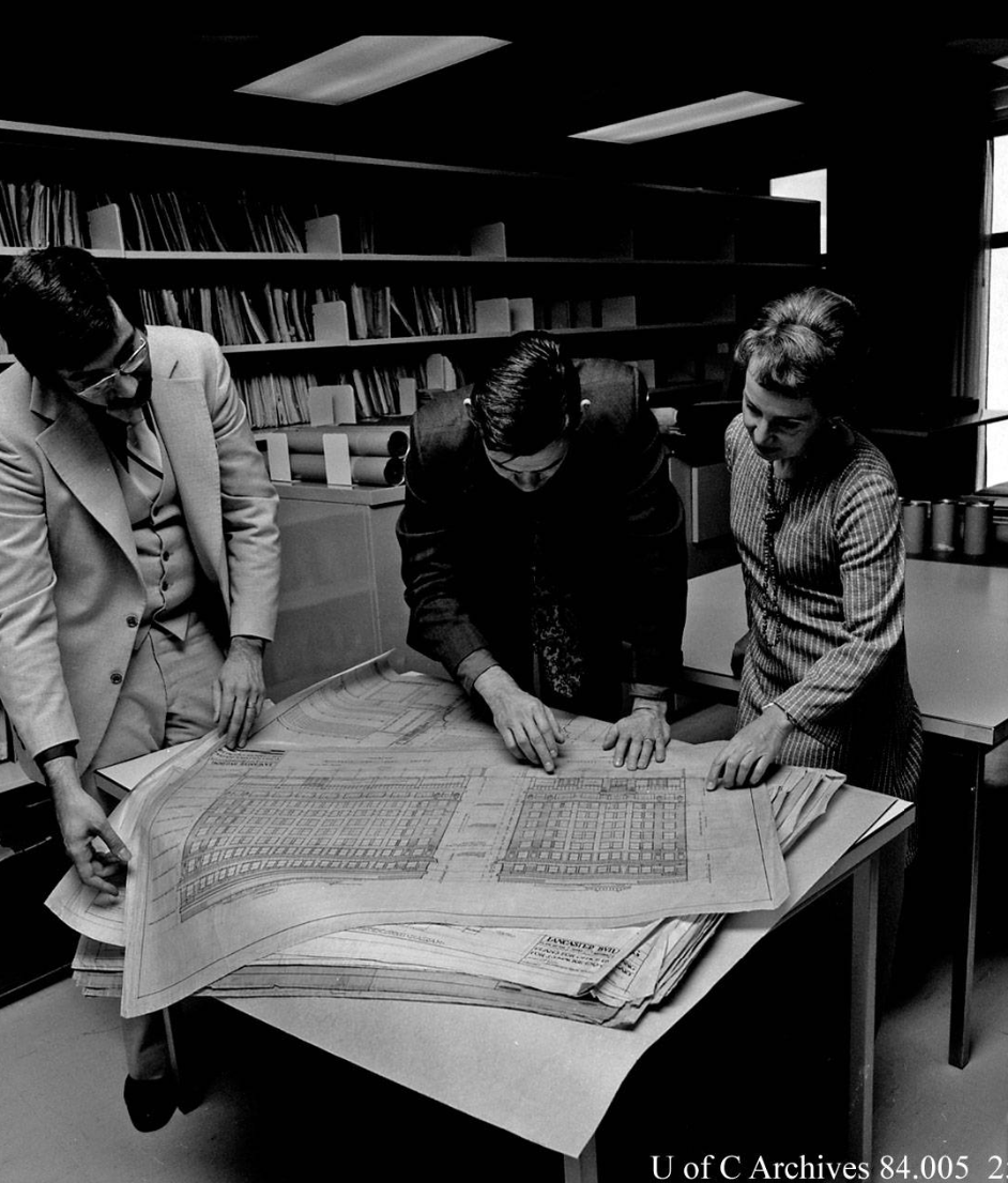 Image of (L to r) Ernie Ingles, librarian; Dr. Michael McMordie, EVDS; Annalise K. Walker, curator, Canadian Architectural Archives; examining documents, October 1977.