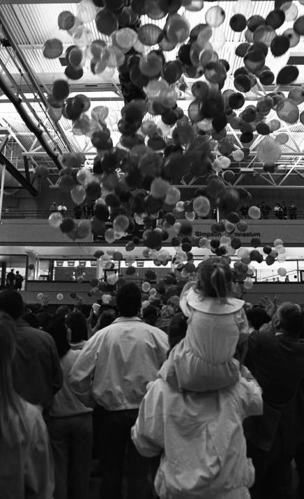 Image of balloons rising to the ceiling of the Jack Simpson Gymnasium during the University of Calgary's 25th anniversary celebration.