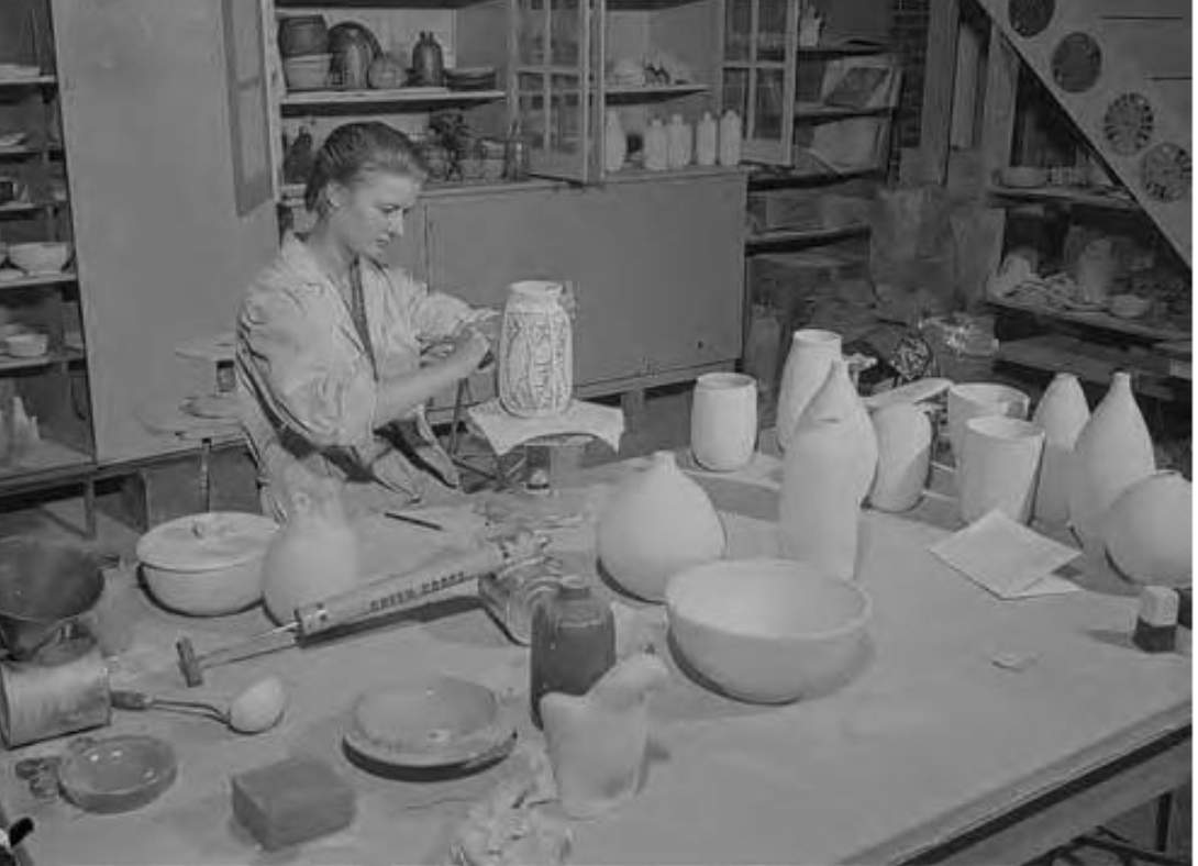Sophie Sembaliuk works on a vase.