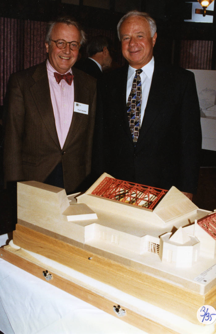 Image of Rozsa Centre architect Fred Valentine of Culham-Pedersen-Valentine and University of Calgary President Murray Fraser with a model of the Rozsa Centre during the groundbreaking ceremony for the performing arts centre.