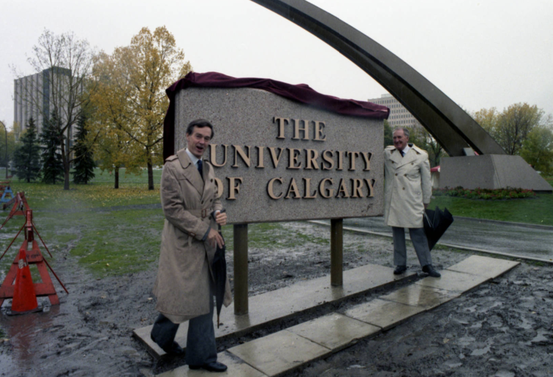 Image of the official ceremony for the unveiling of the University of Calgary entrance arch and sign at the junction of University Drive and 24th Avenue.