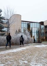 students walking on campus near MacHall