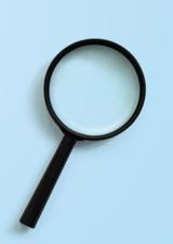 Black magnifying glass on a light blue background