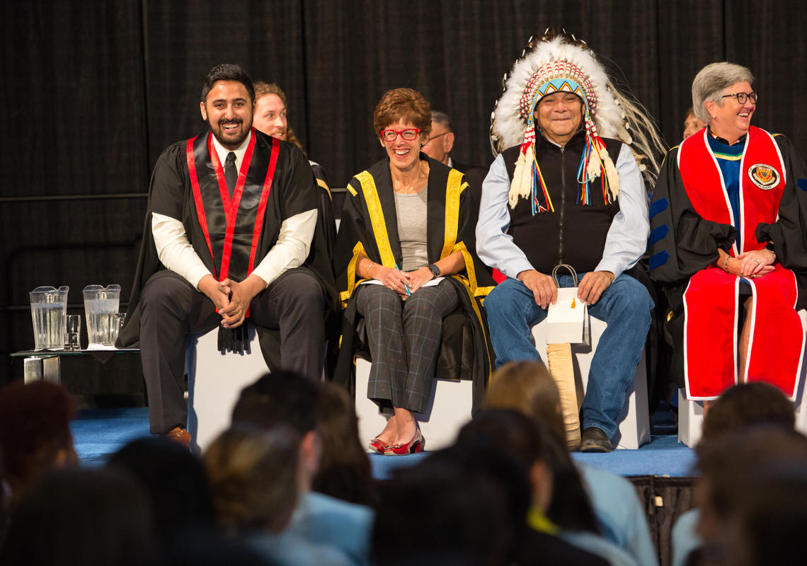 From left: Students' Union President Sagar Grewal, Chancellor Deborah Yedlin, Traditional Knowledge Keeper Kelly Good Eagle, and Provost Dru Marshall.