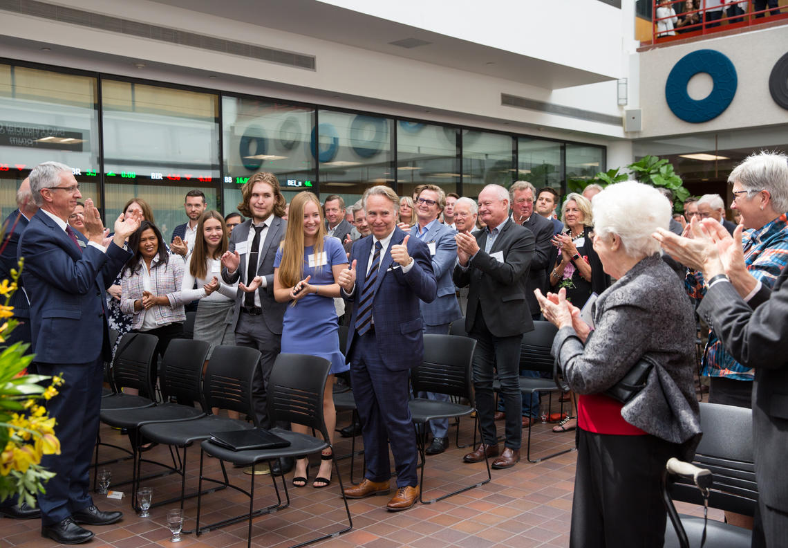 An appreciative University of Calgary audience applauds as Ronald P. Mathison's donation is announced on Friday, helping to fund a second building for the Haskayne School of Business.