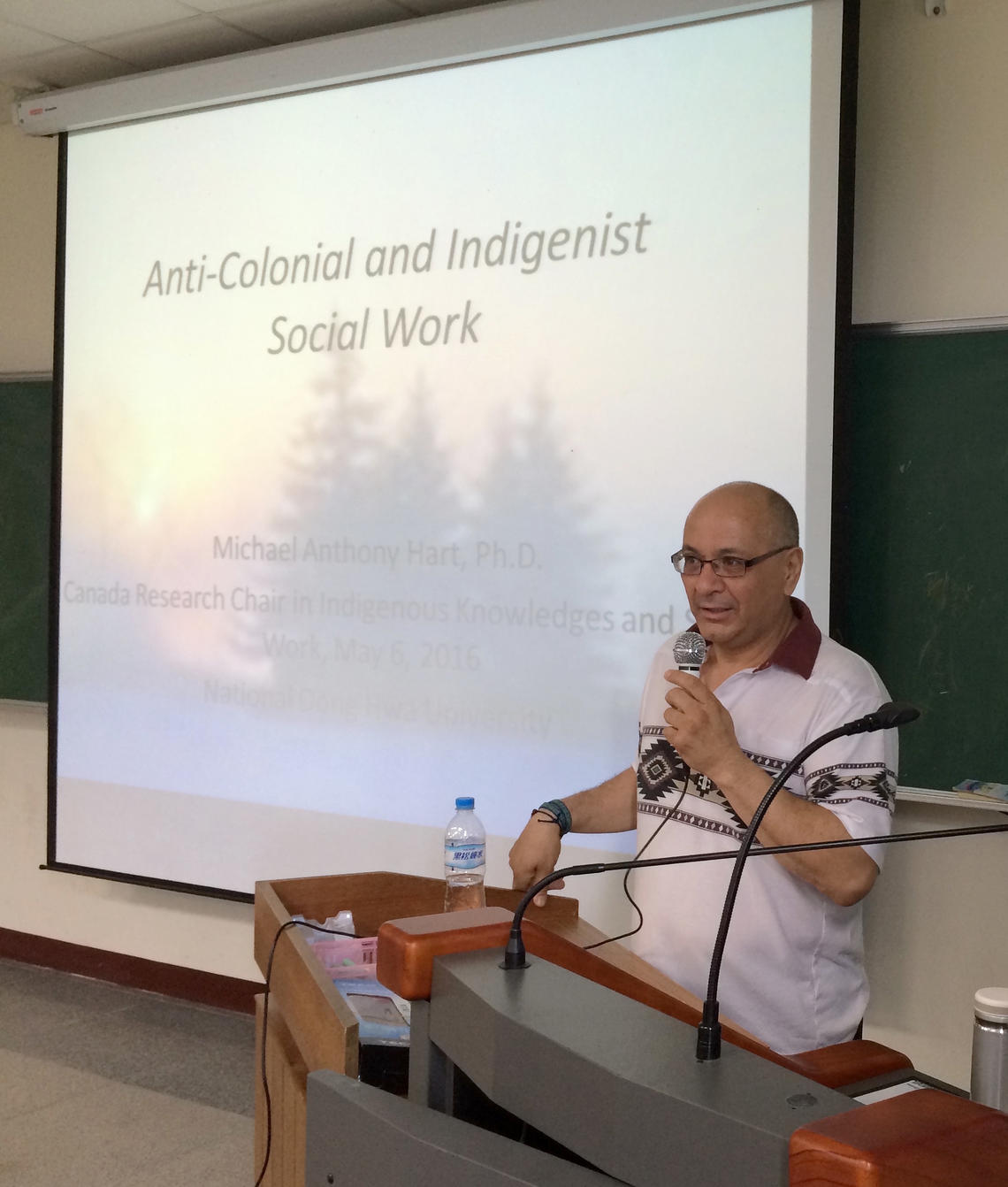 Hart presents his research as Canada Research Chair in Indigenous Knowledges and Social Work in Taiwan, 2016.