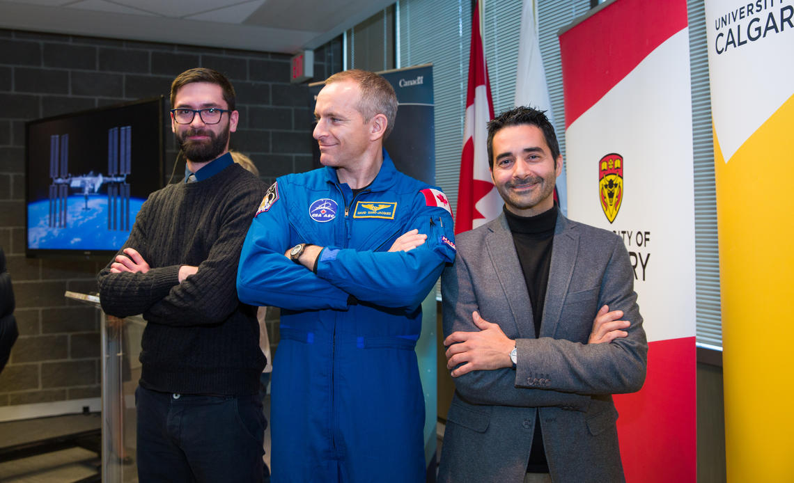 Funding for University of Calgary researcher Giuseppe Iaria's Wayfinding project was announced on Wednesday by the Canadian Space Agency. Pictured with Iaria, at right, are Canadian astronaut David Saint-Jacques, centre, and grad student Ford Burles, a member of the Wayfinding team.