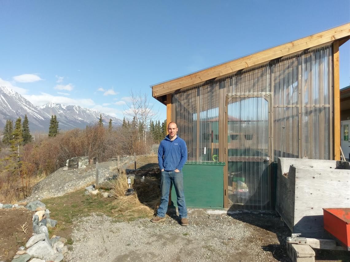 Henry Penn, a postdoctoral scholar with the University of Calgary-led Arctic Institute of North America, at the Kluane Lake Research Station where he is installing the Yukon's first solar-powered Cropbox to try to grow fresh produce year-round. Photo by Robert Reich, Kluane Lake Research Station
