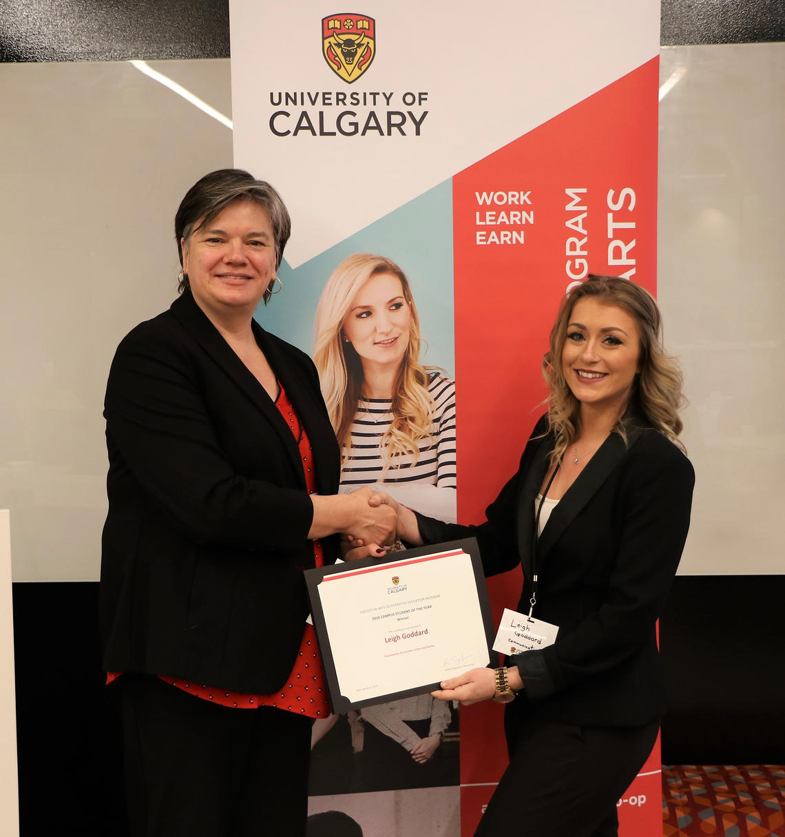 Pascale Sicotte, vice-dean of arts, presents Leigh Goddard with her certificate for winning Student of the Year working for an on-campus office. Goddard was nominated by her employer, Lies Thompson, for her excellent work done during her co-op placement in the Undergraduate Science Centre.