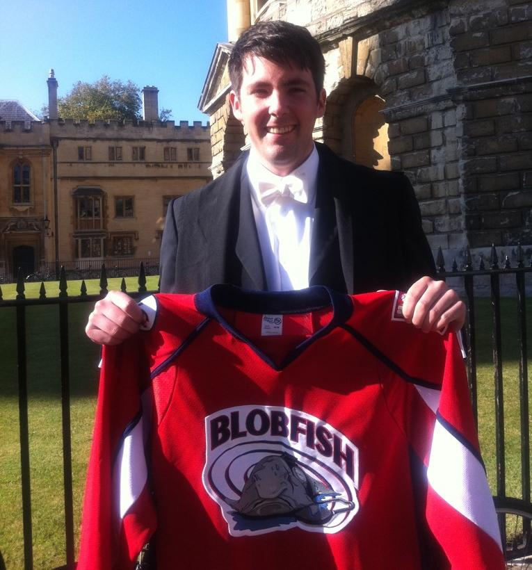 Braden O'Neill, 2015 Cumming School of Medicine graduate and Rhodes Scholar, shows off his team hockey jersey on one of his first days at Oxford. After graduation, O'Neill will be off to the University of Toronto to commence his Family Medicine residency.