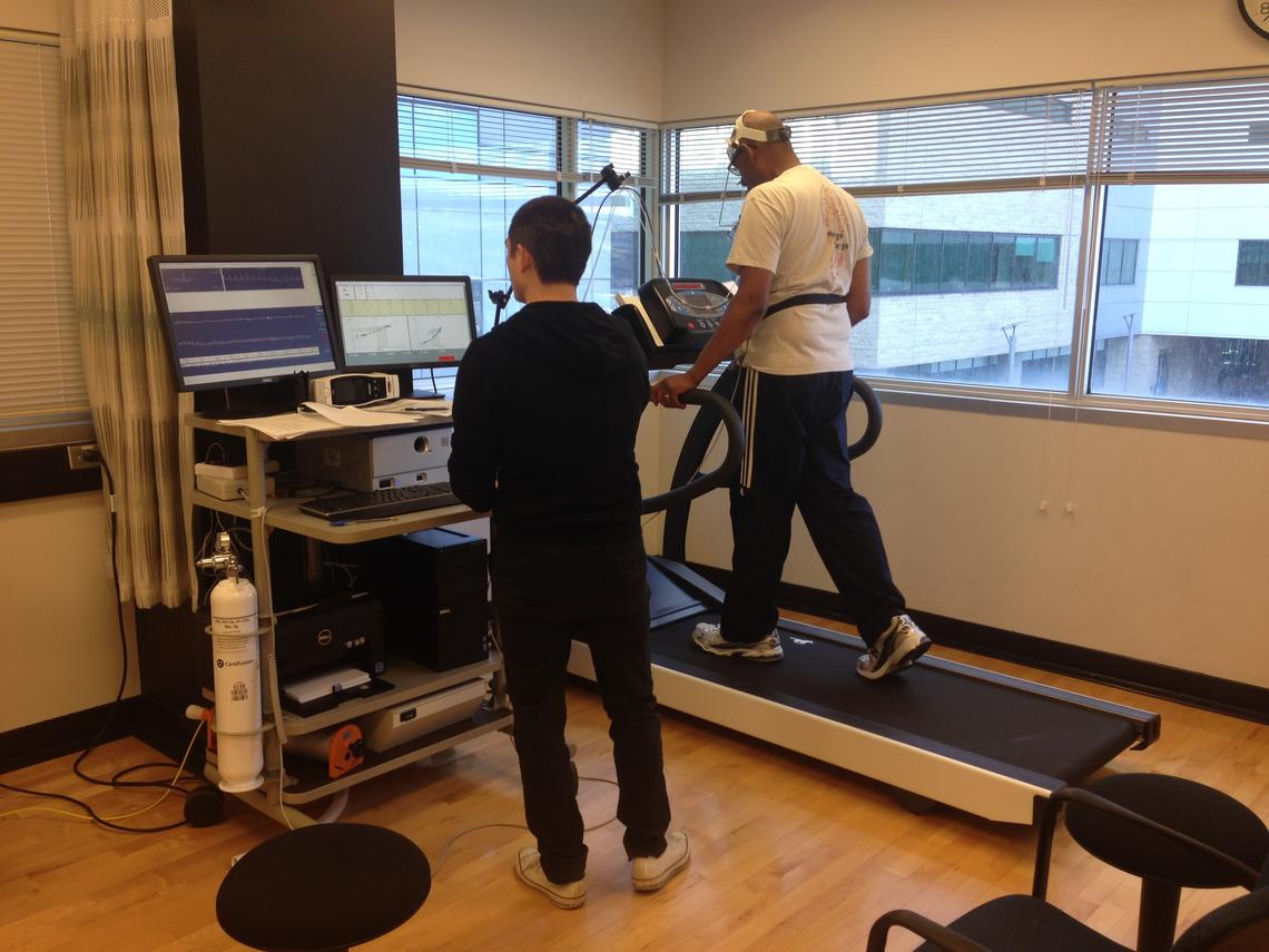 A Brain in Motion research assistant conducts a maximal aerobic capacity (VO2max) test, considered the gold standard for fitness testing, on a Brain in Motion study participant.