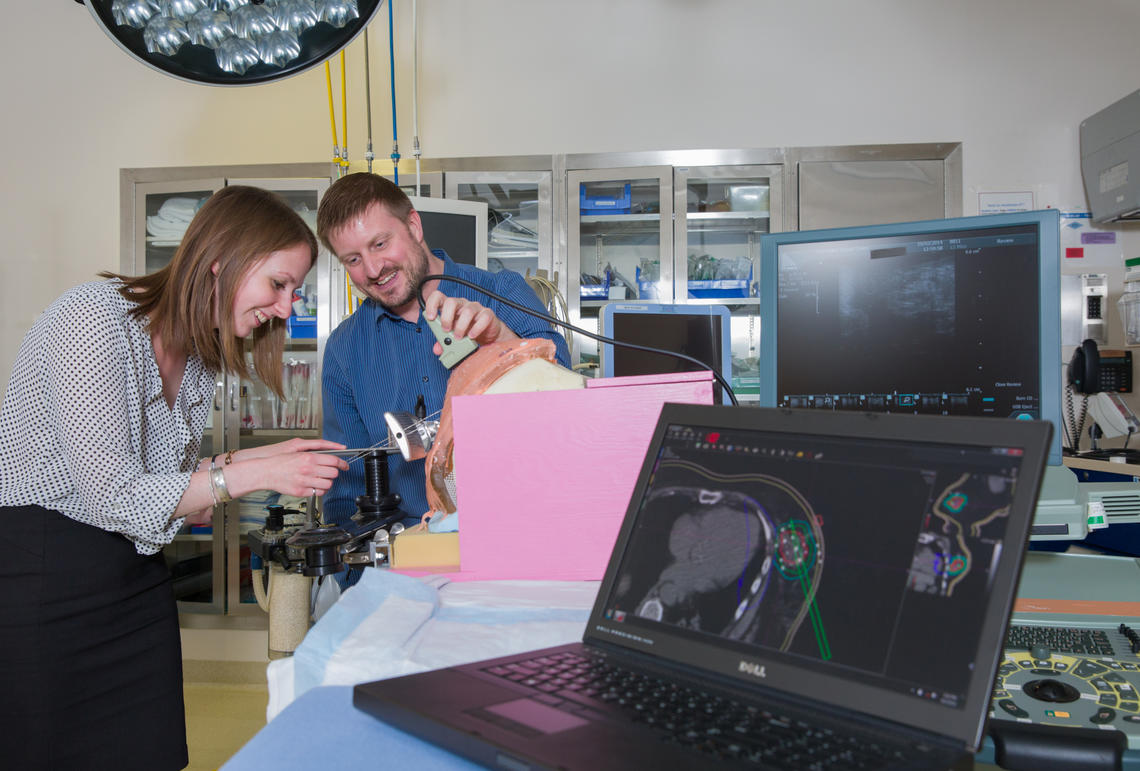 Elizabeth Watt, an MSc student specializing in radiation oncology physics in the Department of Physics and Astronomy, works with Tyler Meyer, an adjunct assistant professor in the  Department of Physics and Astronomy.