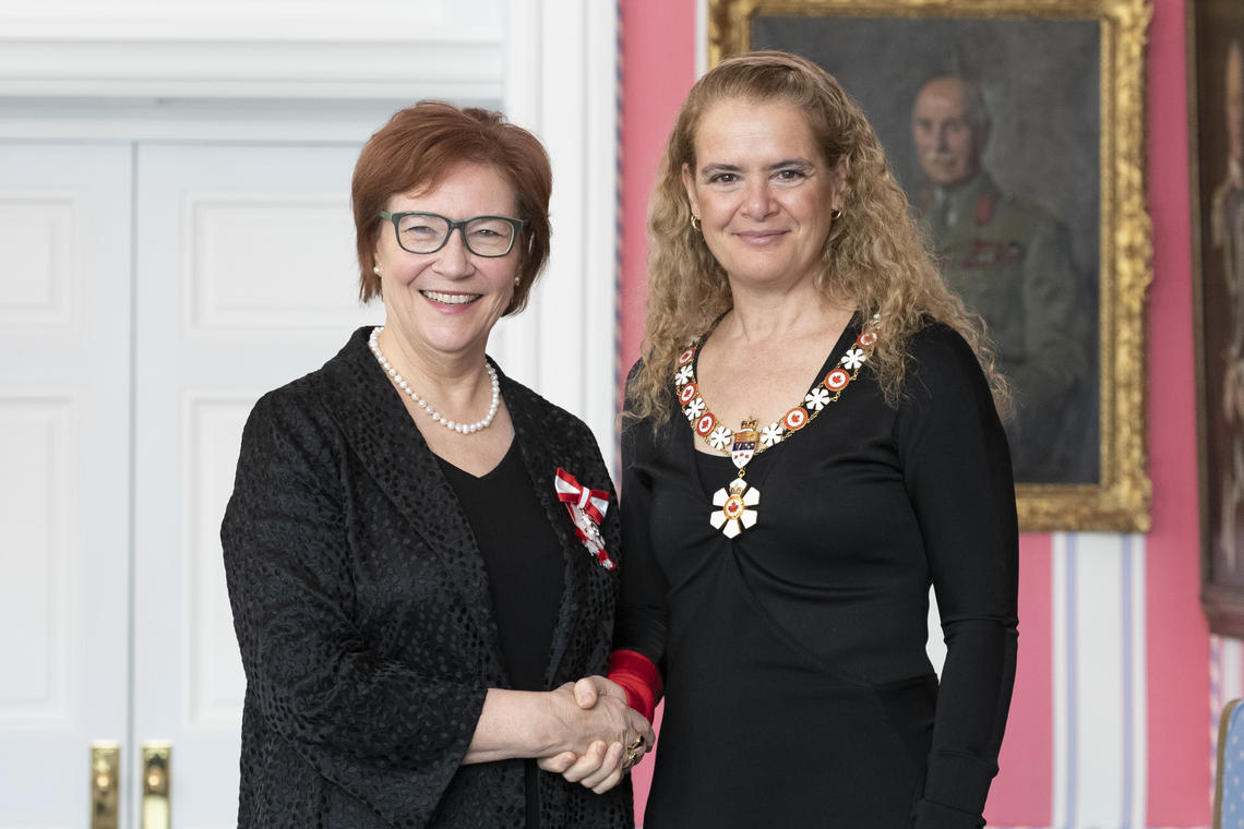 University of Calgary Faculty of Arts prof Aritha van Herk, left, is invested as a Member of the Order of Canada by Governor General Julie Payette, March 14, 2019 in Ottawa.