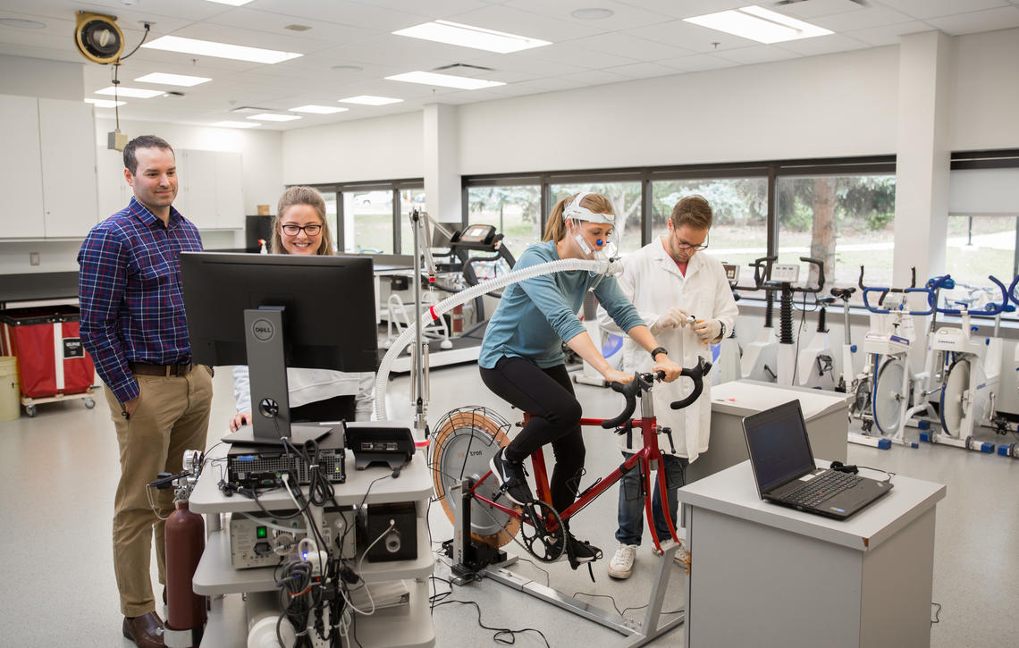 Researchers work with students in the Faculty of Kinesiology's Exercise Physiology Lab.