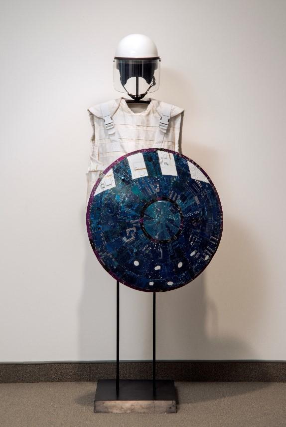 Wally Dion (Canadian, born 1976), Armour Set, 2008, Computer circuit boards, enamel paint, wood, fabric, steel plates, composite riot helmet, various materials, 182.9 x 889 x 50.8, Collection of the MacKenzie Art Gallery, gift of an anonymous donor, 2017-18.