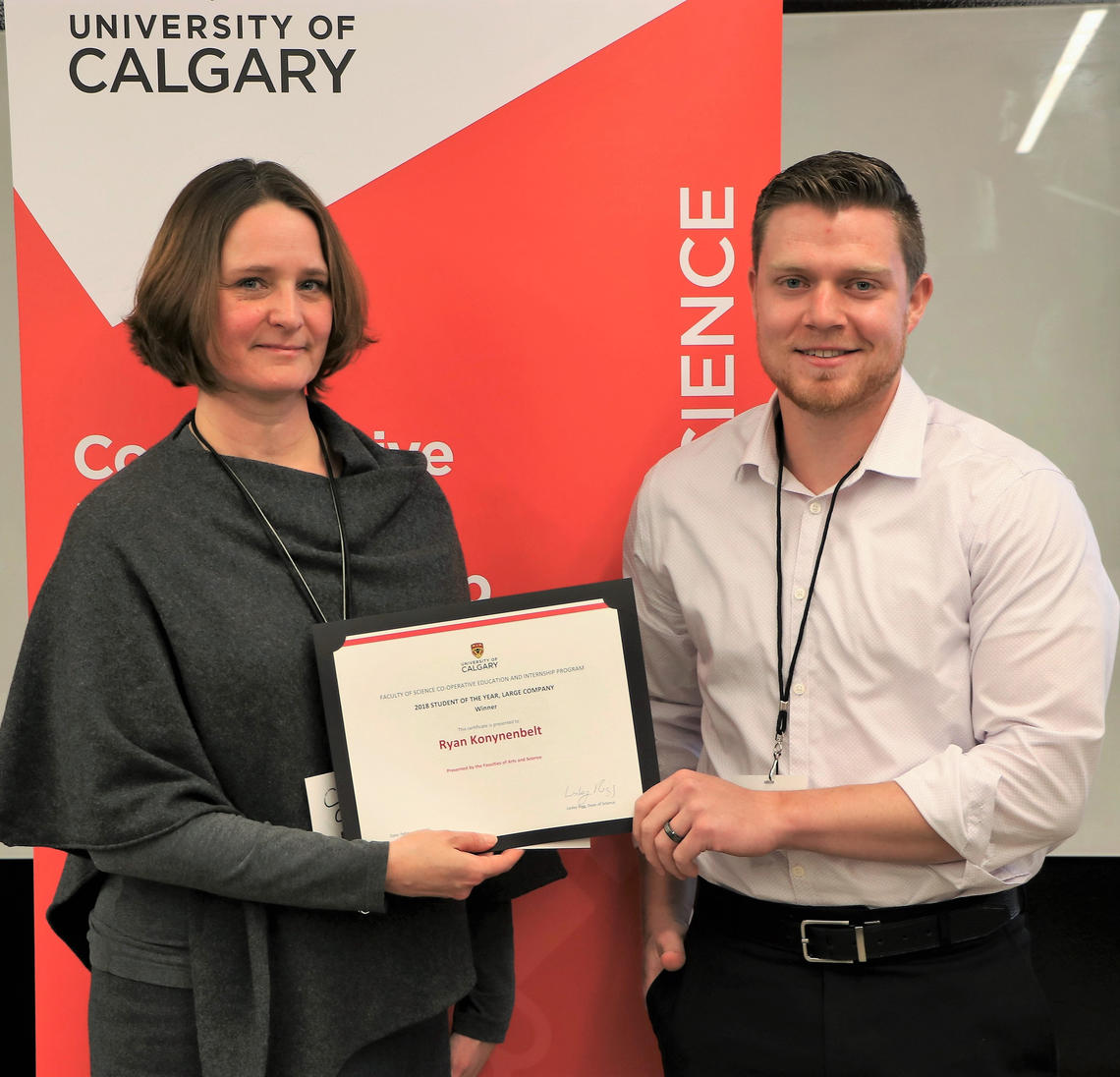 Cindy Graham, vice-dean of science, presents Ryan Konynenbelt with his certificate for winning Student of the Year working for a Large Company. Konynenbelt was nominated by his employer, Gerald LaRiviere, for the work done during his internship at TransCanada.