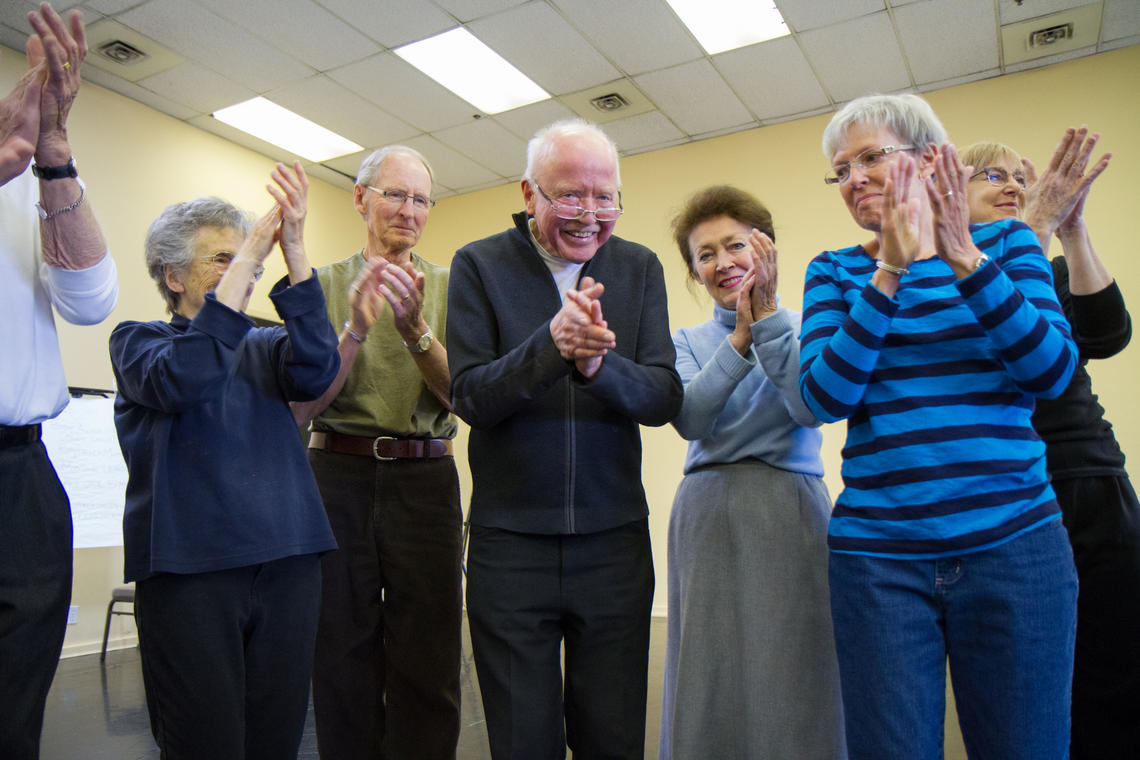 The research study uses weekly dance classes as a therapeutic tool for Parkinson's patients to improve practical motor skills and provide an avenue for social communication and emotional expression.