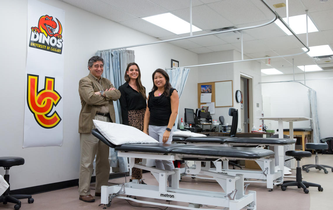 Nick Mohtadi, left, led a clinical trial with Dana Hunter, centre, research assistant, and Denise Chan, research co-ordinator, investigating anterior cruciate ligament (ACL) reconstruction for youth at high risk of knee reinjury. Photo by Riley Brandt, University of Calgary