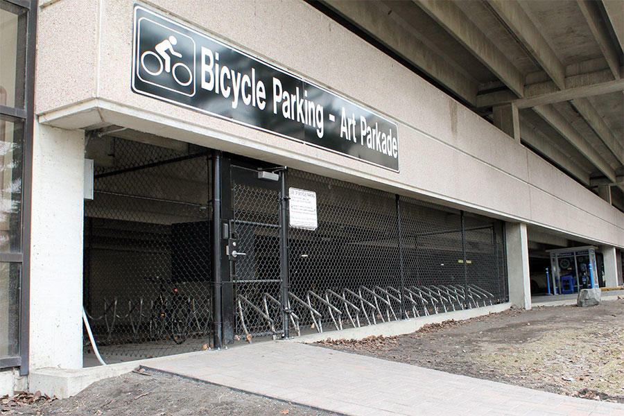 The secure bike compound is located in the southeast corner of the Arts Parkade, accessible from a pedestrian entrance on the east side.