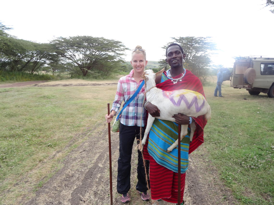 A Maasai warrior brings a ceremonial goat to Lisa Allen Scott at the University of Calgary's One Health field school in the tiny village of Endulen.