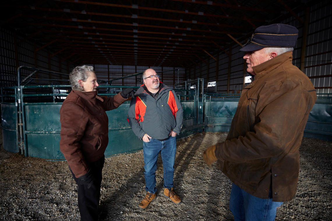 Dr. Grandin discusses cattle handling practices with Ed Pajor and Matt Williams.