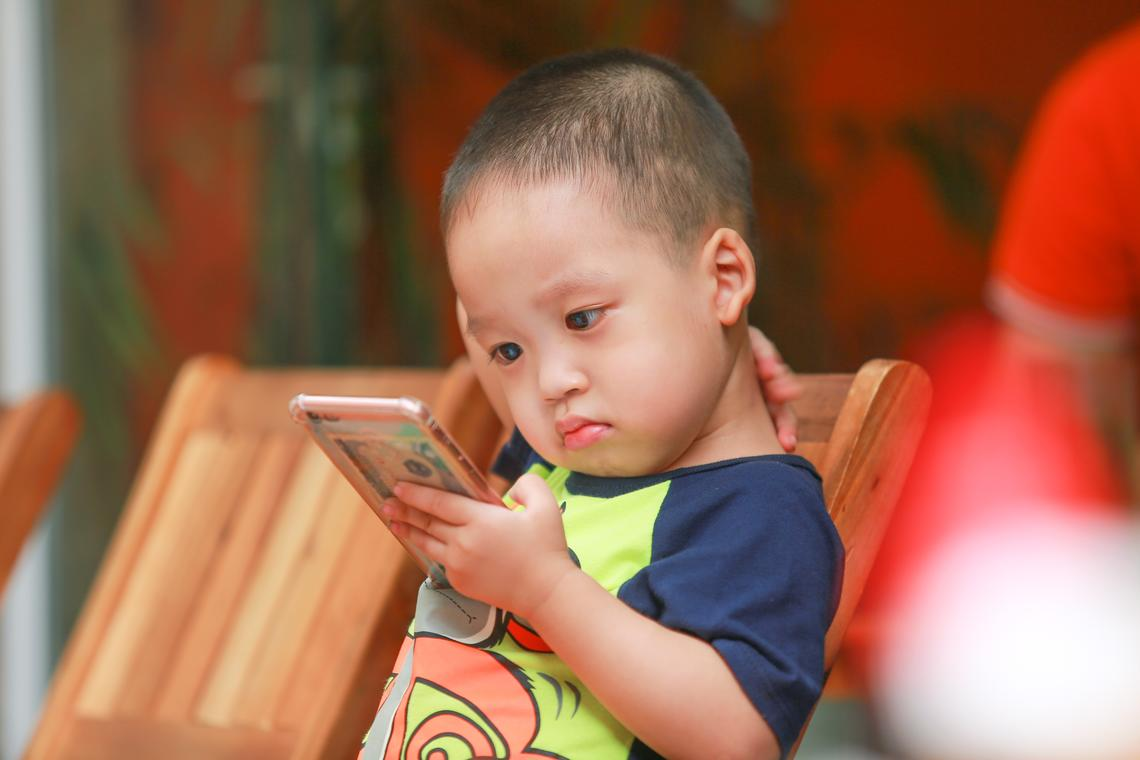 Little boy holding smartphone