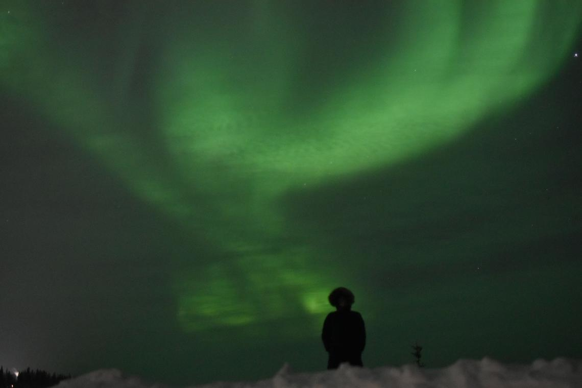 Chesley Zurowski watches the mesmerizing display of aurora borealis in Tulita.