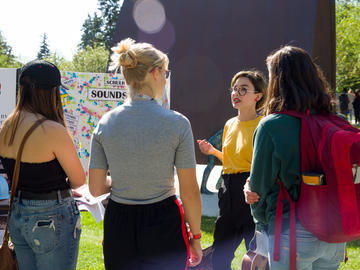 First-year students visit The Campus Expo, an outdoor resource featuring key campus services, and student organizations.
