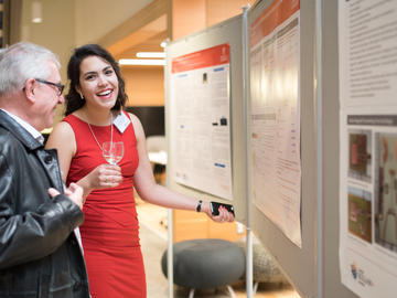 Killam Predoctoral Laureate Annamaris Olmo-Velazquez, Mechanical and Manufacturing Engineering, discusses her research with a guest