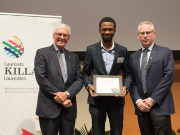 Killam Predoctoral Laureate Adedapo Awolayo, Chemical and Petroleum Engineering, with Killam Trustee Kevin Lynch (left) and Dr. Ed McCauley, vice-president (research)