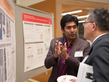Killam Predoctoral Laureate and winner of the 2017 Byers Award Mallik Mahmud, Geography (left) discusses his work with Killam Visiting Scholar Dr. Steven Chien