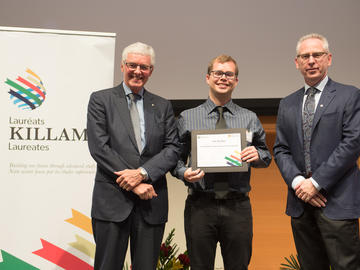 Killam Predoctoral Laureate Seth McAfee, Chemistry, with Killam Trustee Kevin Lynch (left) and Dr. Ed McCauley, vice-president (research)