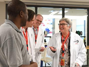Christopher Simon, Dr. Bill Rosehart, Dr. Anders Nygren and Dr. Dru Marshall make their way through the engineering labs for their health and safety tour