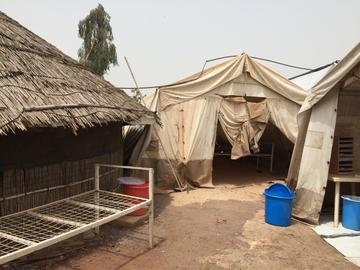 A tukul (mud hut) on the COVID unit at the UN encampment where Baloch works with MSF.