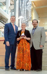 Valerie Pruegger, director of the Office of Diversity, Equity and Protected Disclosure, celebrates her Faculty of Arts Award with Dean Richard Sigurdson, left, and Michael Sclafani, associate vice-president, Alumni Engagement and Partnerships.