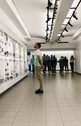 A Master of Architecture student learns about the housing situation in Tijuana while Prof. Hamels' Research Studio 6 peeks into the gallery.