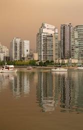 A smokey haze from wildfires burning in the region blankets Vancouver, B.C.