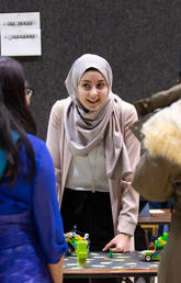 Bachelor of Education student Raneem Elhowari explains the role robots can play in preventing forest fires at the recent Werklund School STEM showcase. Photo by Riley Brandt, University of Calgary