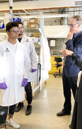 Chancellor Deborah Yedlin in the lab with chemical engineering students.