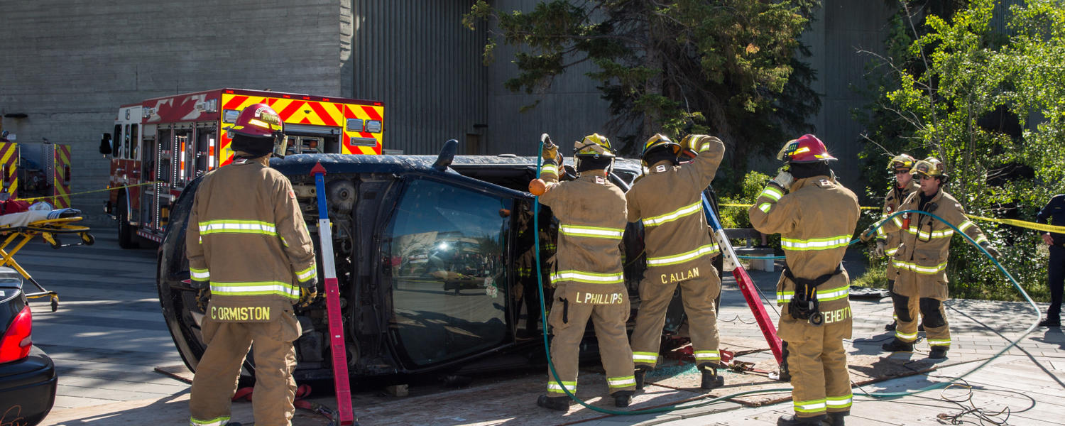 Firefighters demonstrate an emergency vehicle extraction